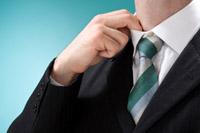 Man adjusting his collar as if nervous